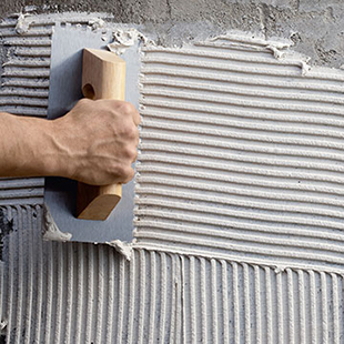 1. Spread a coat of adhesive-based cement across the surface, ensuring that it is flat and even.